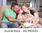 Parents are reading book for their children. - stock photo