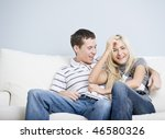 Cropped view of affectionate couple laughing and relaxing together on white couch. Horizontal format. - stock photo