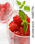 Raspberries in glass - stock photo