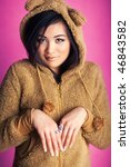 Young japan woman in bear suit. Sweet portrait. - stock photo