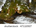 Moss and waterfall in winter - stock photo