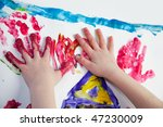 Little Children Hands doing Fingerpainting with vivid colors - stock photo
