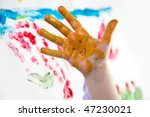 Little Children Hands doing Finger painting with vivid colors - stock photo