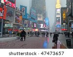 MANHATTAN - FEBRUARY 25: Commuters and tourists in Times Square during the latest snowstorm on February 25, 2010 in New York City. - stock photo