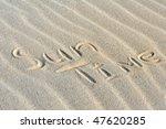 """Inscription """"Sun Time""""  on a sand. - stock photo"""