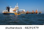 Dredger Geopotes 15 getting ready to discharge - stock photo