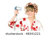 woman in hair curles hold hair dryer - stock photo