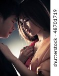Young japan couple in love. Shallow dof effect. - stock photo