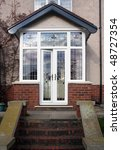 House entrance enlosed with a uPVC porch - stock photo
