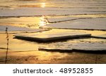 Wloclawek in Poland - sunset. Hacked off with ice the Vistula, ice floe on the river. - stock photo