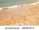 sea wave and sand - stock photo