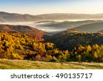 cold morning fog with red hot sunrise in the mountains - stock photo
