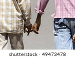 two indian boys walk hand in hand - photo taken in Delhi. - stock photo