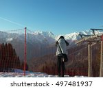 Girl looking at snow-capped mountains - stock photo
