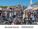 "DAYTONA BEACH, FL - MARCH 6:  Crowd in front of the Harley-Davidson Motorcycle Dealership on Main Street during ""Bike Week 2010"" in Daytona Beach, Florida. - stock photo"