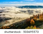 cold morning fog with golden hot sunrise in the rural area of Carpathian mountain range - stock photo