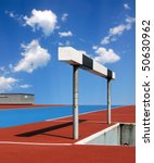 Hurdle on an athletic track with blue sky - stock photo