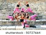 Beautiful modern dancers on the ancient stairs of Kourion amphitheatre in Cyprus. - stock photo