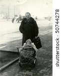 Vintage photo of mother with a baby in pushchair (1955) - stock photo
