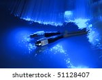 network cable closeup with fiber optical background - stock photo