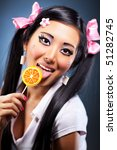 Young japanese woman with lollipop portrait. - stock photo
