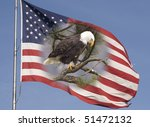 A bald eagle and the flag that represent freedom in America. - stock photo