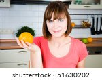 Young happy woman with orange - stock photo