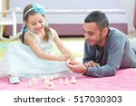 Little Girl Is Playing With Toys Together With Her Father - stock photo
