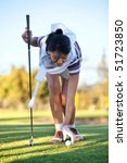 Young woman playing golf in a country club - stock photo