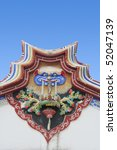 Traditional Chinese temple building against blue sky - stock photo