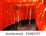 the thousand torii gates with names of donators - stock photo
