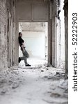 Young woman in ruined building. Loneliness concept. - stock photo