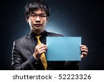 Young japan businessman with blank page. Contrast colors. - stock photo