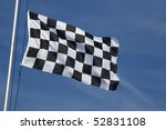 checkered flag waving in the breeze - stock photo
