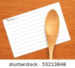 blank recipe card with wooden spoon - stock photo