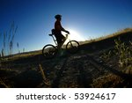 Mountain biking up a trail in the mountains - stock photo
