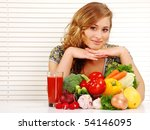 Beautiful young woman and vegetables on the table - stock photo