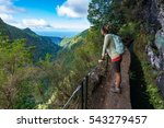Young woman tourist  enjoying beautiful view of the valley. - stock photo