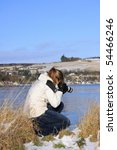 Blonde girl engaging in outdoor photography, Northern Scotland - stock photo