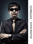 Cool japanese man in sunglasses portrait. - stock photo