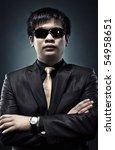 Cool japanese man in sunglasses portrait. - stock photo