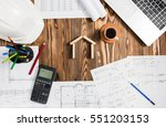 Engineer's Desk In Office With Various Gadgets, View From Top With House Concept - stock photo