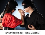 Young japanese couple fighting. Focus on hand and faces. - stock photo