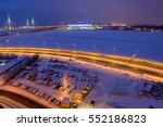 Saint-Petersburg, Russia - January 2, 2017: Top view of a cityscape at night, cable-stayed bridge, the frozen river, a football stadium and parking lot. - stock photo