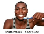 a young man is excited about brushing his teeth,  isolated on white - stock photo