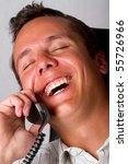 A laughing man on telephone - stock photo