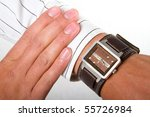 A man checking the time on his wrist watch - stock photo