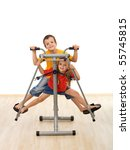 Kids playing on leg trainer fitness equipment in the gym - isolated - stock photo