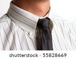 A close up of a black tie and white, striped shirt - stock photo