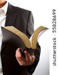 A man reading from the holy bible - stock photo